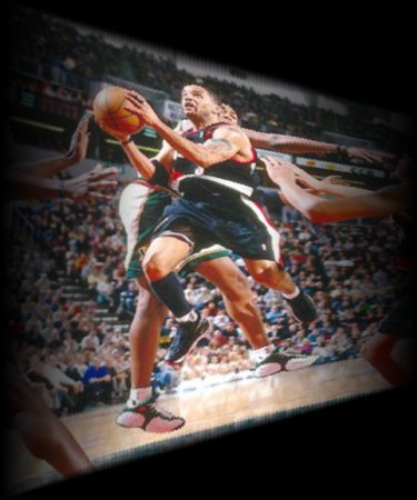 Stoudamire drives against the Sonics
